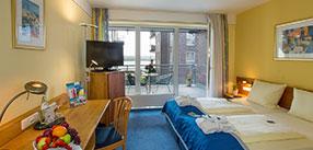 Komfortzimmer mit Balkon und direktem Blick auf den Rhein